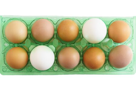 Multicolored chicken eggs in new plastic store packaging. Unequal