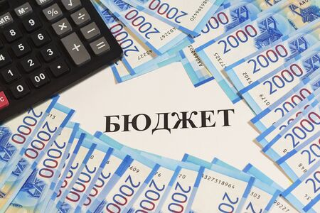 Estimates of income and expenses. Calculator, cash rubles and Russian text of