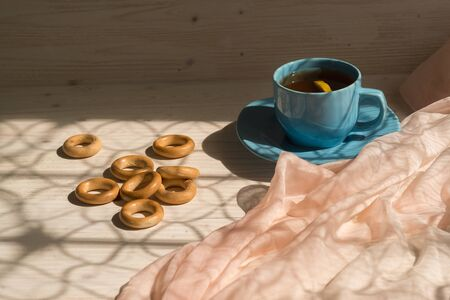 Morning tea with bagels on the table. Sunlight from the window. Lifestyle