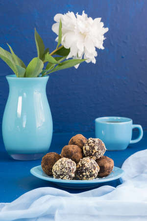 A portion of home energy balls on a blue background. Delicious and healthy dessert for Breakfast. Lifestyle
