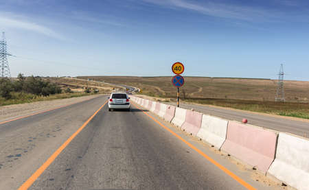 Cars are traveling on the reconstructed section of the A-289 highway from Krasnodar to Crimea. The speed limit is 40 kilometers per hour