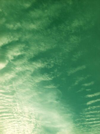 float cotton cloud: Green sky with clouds Stock Photo
