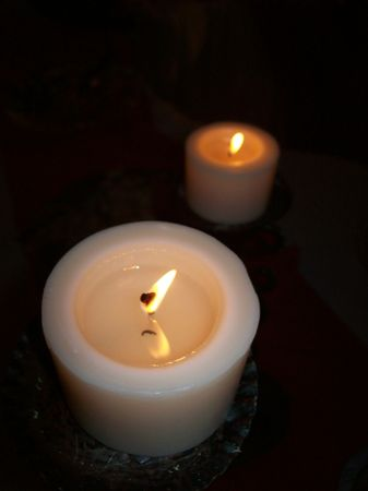 Couple of white cylindrical lighten candles Stock Photo - 5652286
