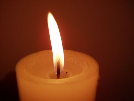 Yellow light of a candle flaming Stock Photo - 5652284