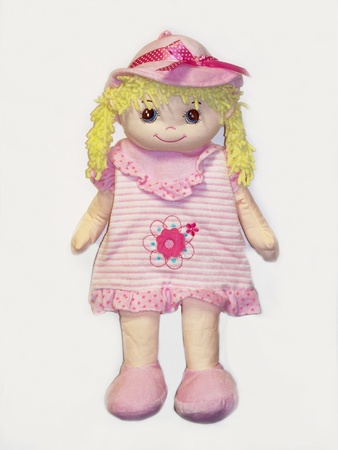 Blonde fabric doll in pink