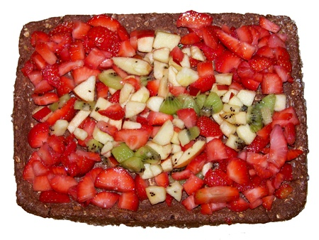 Delicious raw rectangular chocolate and fruits cake photo