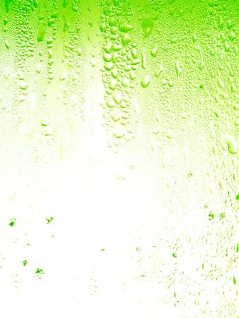 rains: Lemon soda background with little drops texture Stock Photo