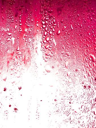 condensación: Granadina, el bicarbonato de la fruta cae de condensación en el fondo de vidrio de textura