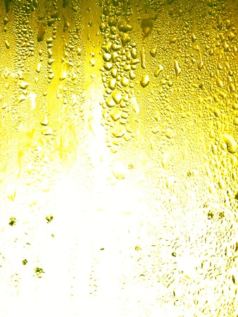 Beer glass surface with little water drops condensation