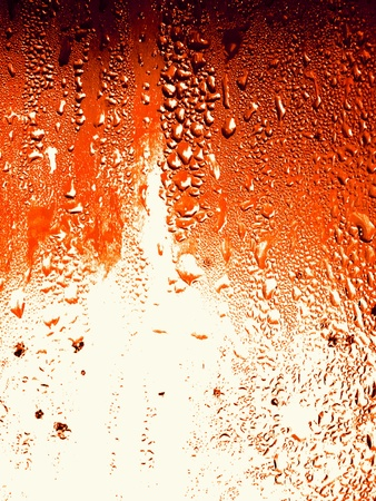 Orange cola condensation drops on glass surface background photo