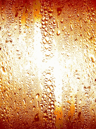 Orange soda glass with water condensing in little drops background photo
