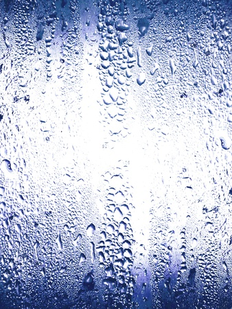 rains: Soft blue glass with water drops textures Stock Photo