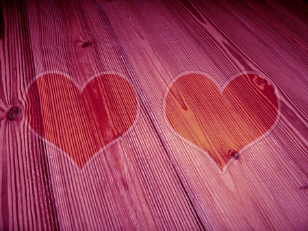 pinks: Couple of heart shaped frames of old wood in violet pinks
