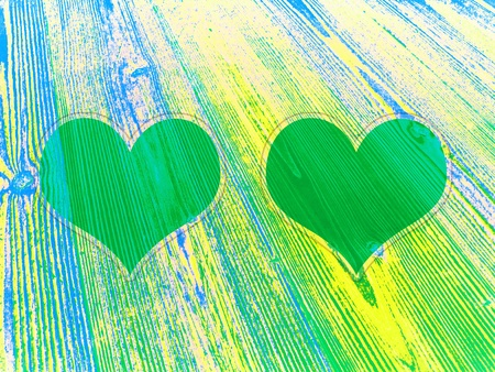 romaticism: Pair of green hearts photo frames on fresh juvenile wood background Stock Photo