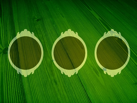 Old frames on dark green woods background  photo