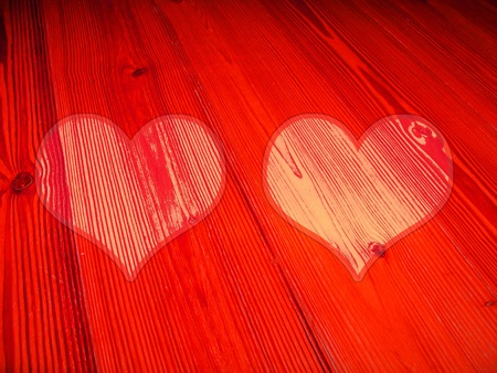 Two hearts on passionate red old wood background texture