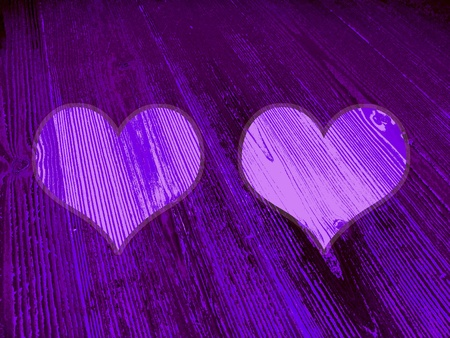 romaticism: Two violet heart for love alchemy on rustic old wood textured background
