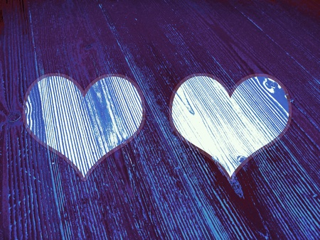romaticism: Two, pair, couple of romantic hearts on old blue wood texture