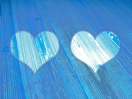 romaticism: Two hearts in juvenile blues wood textured background Stock Photo