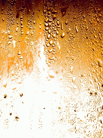 Surface texture of a cold beer glass as background photo