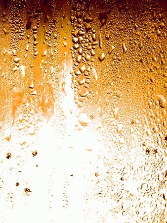 cerveza: Textura de la superficie de un vaso de cerveza fr�a como tel�n de fondo Foto de archivo