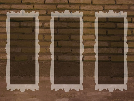 Brown or sepia background of brickwall with oldish empty frames photo
