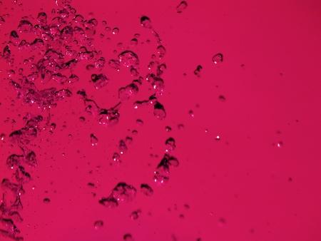 magentas: Dark magenta background with liquid drops splash
