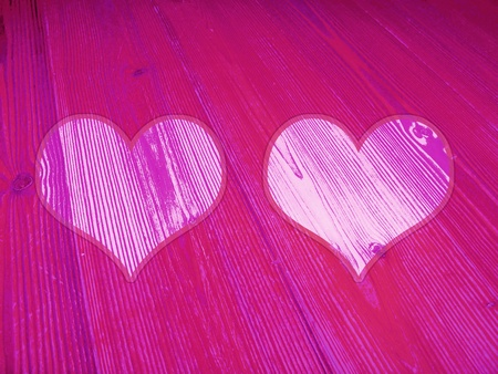 magentas: Two passionate Valentine hearts of wood background Stock Photo