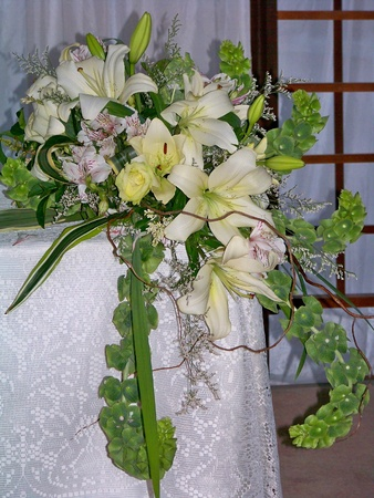 Elegant weding white and green flowers bouquet or arrangement on a table
