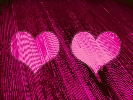 romaticism: Couple of pink and magenta hearts on dark old striped wood background Stock Photo