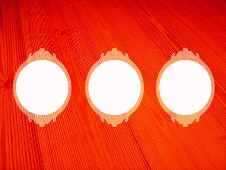 Brilliant red wood background with three circular isolated white empty frames photo