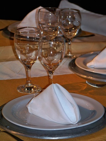 Detail of a wedding table prepared in white and gold  photo