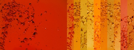 instrospection: Warm large horizontal background with orange and red drops of liquids Stock Photo