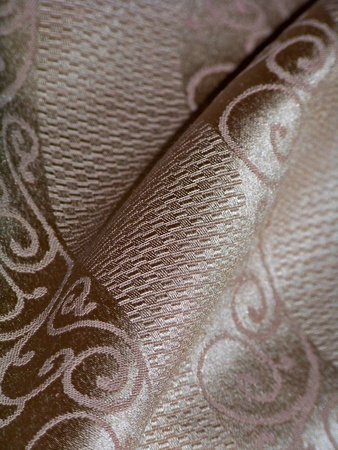 sofisticated: Sofisticated fabric detail of a textured golden party tablecloth Stock Photo