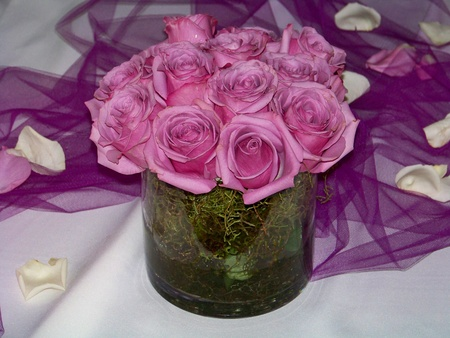 Marriage or wedding flowers arrangement of pink roses on an elegant table photo