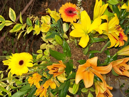 chalices: Party yellow and orange flowers arrangement, lily and gerber