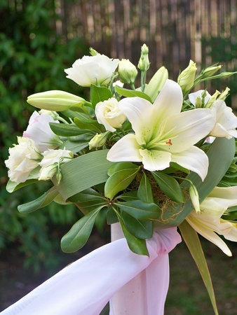 Wedding ceremony white lilies bouquet elegant flowers photo