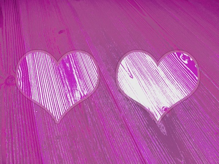 Couples of hearts in old wood colored striped wood in pinkish violet and white photo