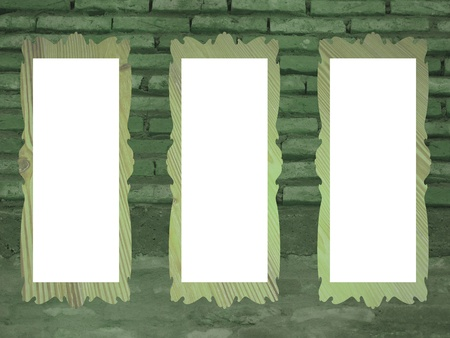 Rustic green brickwall background with white spaces for pictures in rectangular frames photo