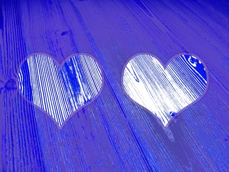love pic: Two romantic blue hearts on striped old wood textured background
