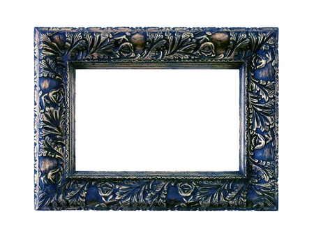 Dark blue and silver vintage wood frame with carved design on white Stock Photo