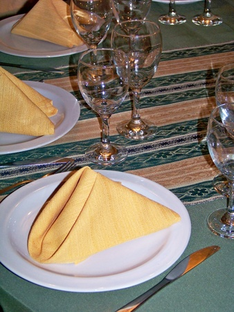 yellows: Elegant party  tableware service on a table in green, white and yellow Stock Photo