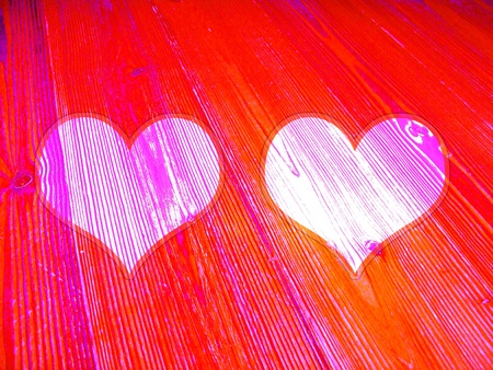 romaticism: Brilliant red wood striped background with two light hearts