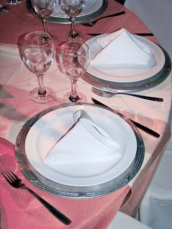 Luxurious dinner elegant tableware in soft femenine pink silver and white on circular table photo