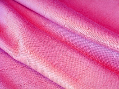 Shinny fuchsia pink cloth close up detail background photo
