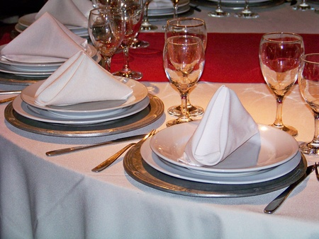warm cloth: Fsetive restaurant table service in red white and silver in horizontal view