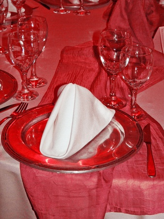 Passionale romantic festive restaurant table in intense red and dark pink photo