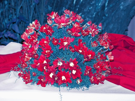 aniversaries: Rarity of daisies spherical bouquet on a table in red white and blue, USA patriotic colours