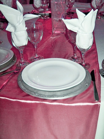 Sophisticated event dinner table in brilliant metallized pink, white and silver photo