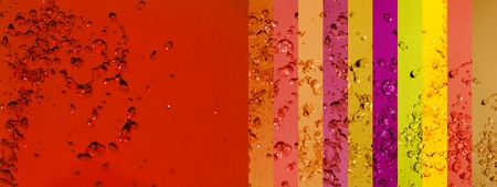 Warm palette background in red oranges and yellow with water drops splash